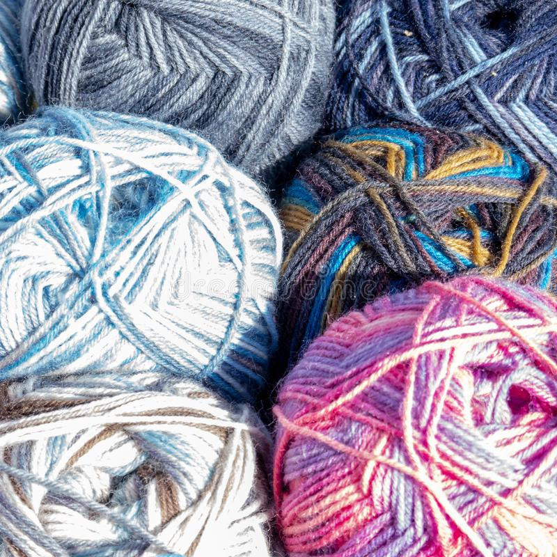 Close-up of colourful balls of wool on the sales stand of a flea market stock photography