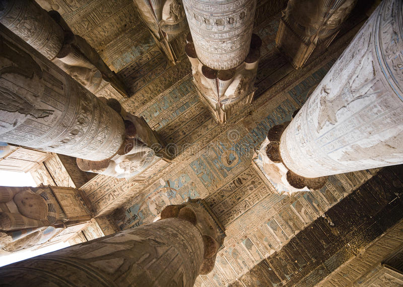 Close-up of columns and ceiling covered in hieroglyphics royalty free stock photography
