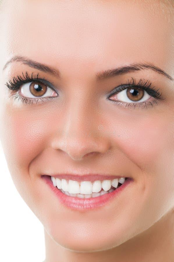 Close-up com sorriso da cara da mulher imagens de stock royalty free