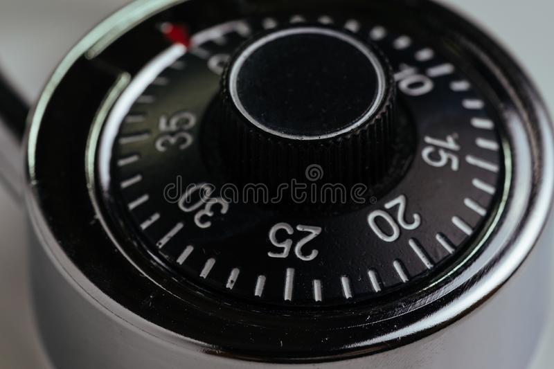 Close up of combination lock with circle of numbers and code to unlock using as security, safety and hacking concept stock photography
