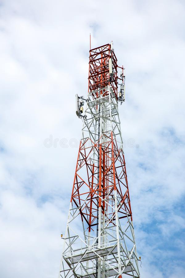 Close up communication tower top. Radio antenna Tower. Microwave antenna tower on light sky background. wireless technology concept. communication development royalty free stock photography