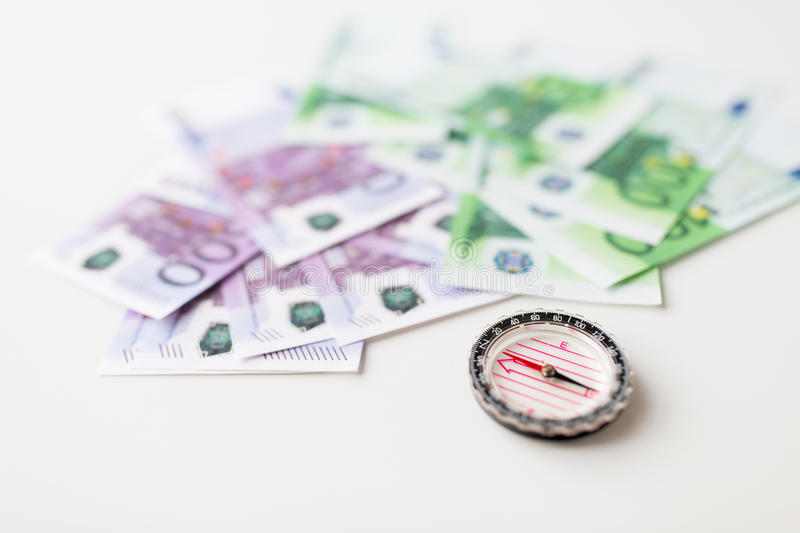 Close up of compass and euro money on table stock photo