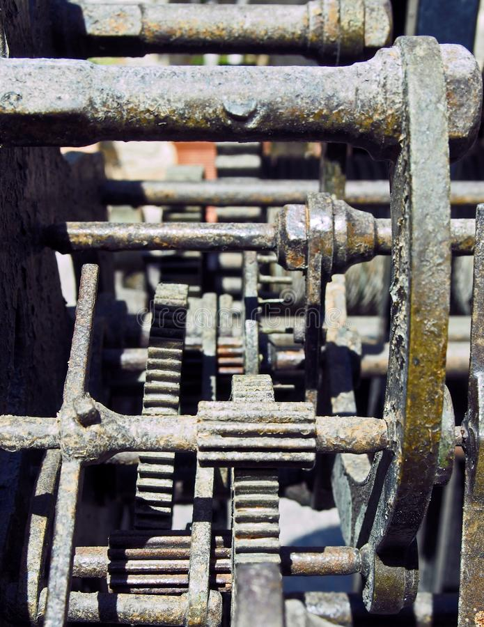 Close up of complex gears and cogwheels on old rusting steel machinery stock photos