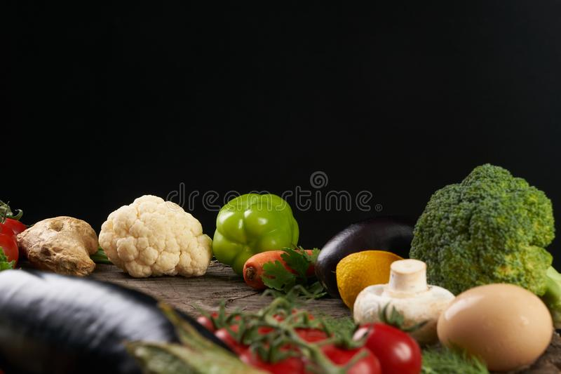 Close-up composition with assorted raw organic fresh vegetables royalty free stock photography