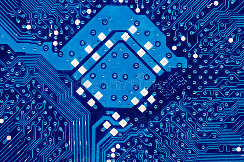 Close up of computer circuit board in blue. Macro royalty free stock image