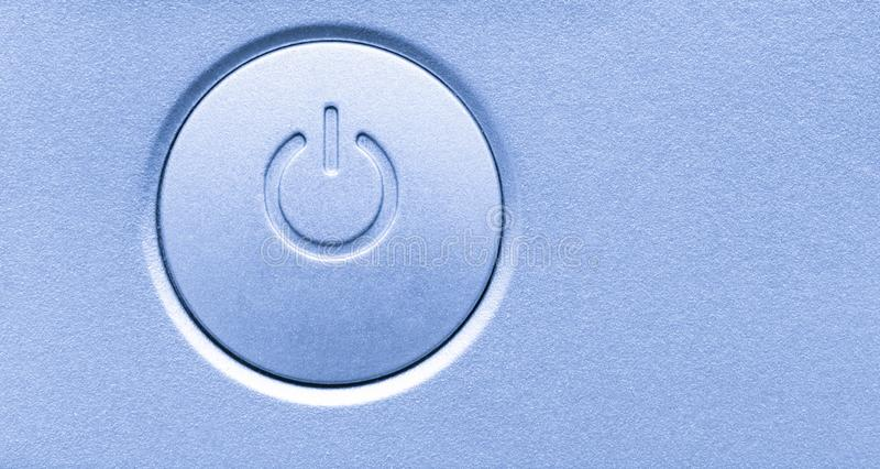 Close up of computer electronic device on/off power button. Horizontal background modern technology symbol icon. stock image