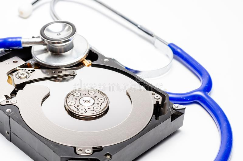 Close up computer hard disk and stethoscope data health check, data security concept on white background.  stock photos