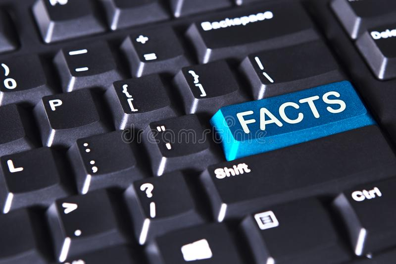 Computer keyboard with fact word. Close up of computer keyboard with fact word on the blue button royalty free stock photos