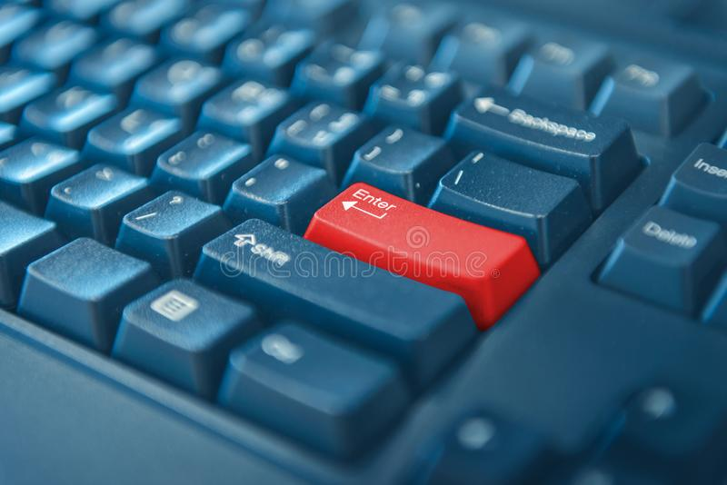 Computer keyboard with red button. selected focus on enter button. Close-up of computer keyboard with red button. selected focus on enter button royalty free stock image