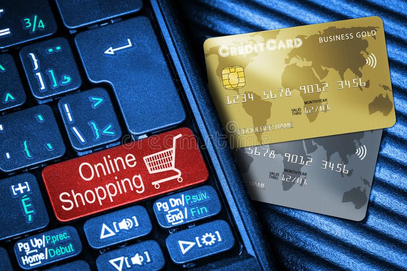 Credit Cards and Keyboard With Red Button Online Shopping Concept. Close up of computer laptop keyboard on generic credit cards with red button Online Shopping stock images
