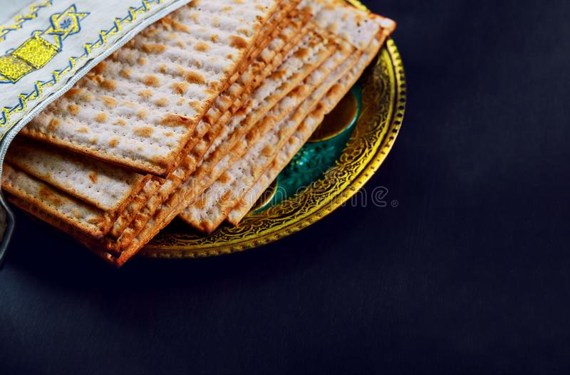 Close up of concept jewish holiday passover matzot and tallit the substitute for bread on the Jewish Passover holiday royalty free stock images