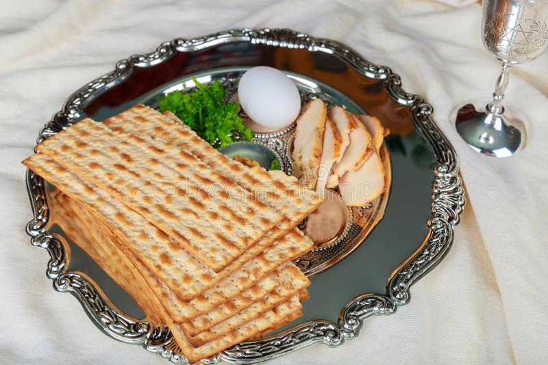 Close up of concept jewish holiday passover matzot and tallit the substitute for bread on the Jewish Passover holiday stock photo