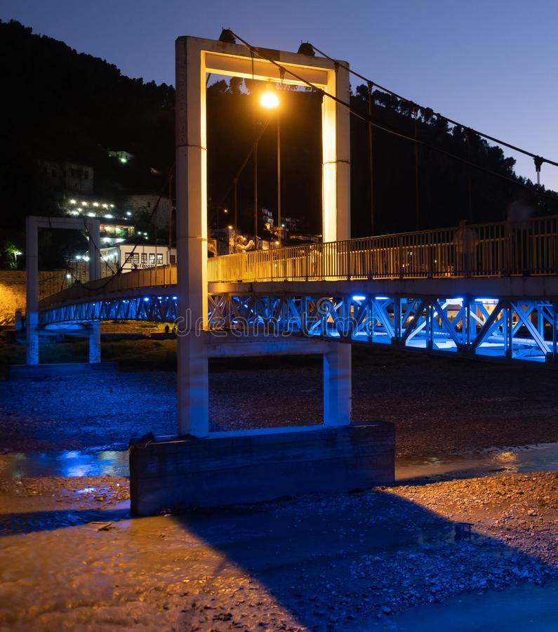 Close Up of the Concrete Support of Berat`s Suspension Bridge Lit in Blue and Gold royalty free stock photography