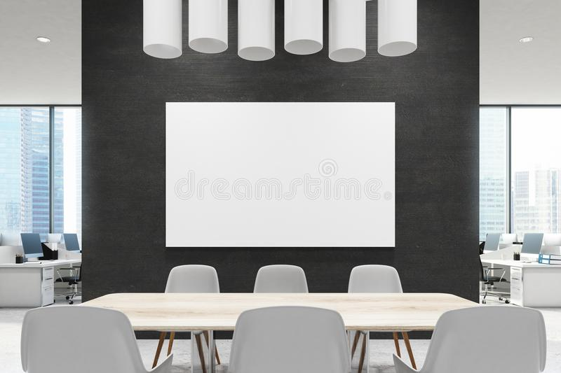 Close up of a conference room table, black, poster. Close up of a wooden table in a meeting room of an office with a black wall, an open office area in the stock photography