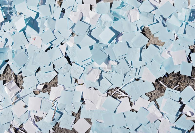 Close-up of confetti on the street sun day stock photography
