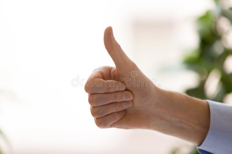 Close up confident businessman show thumbs up, business achievem. Ent, hand view, satisfied happy client, customer recommend service, successful work, motivated royalty free stock images