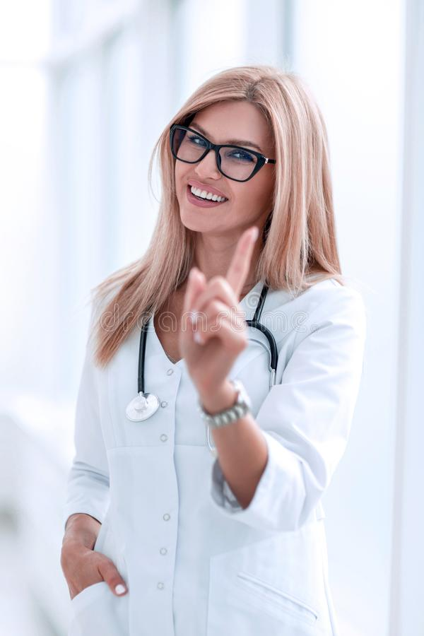 Confident woman doctor standing in hospital lobby stock photos