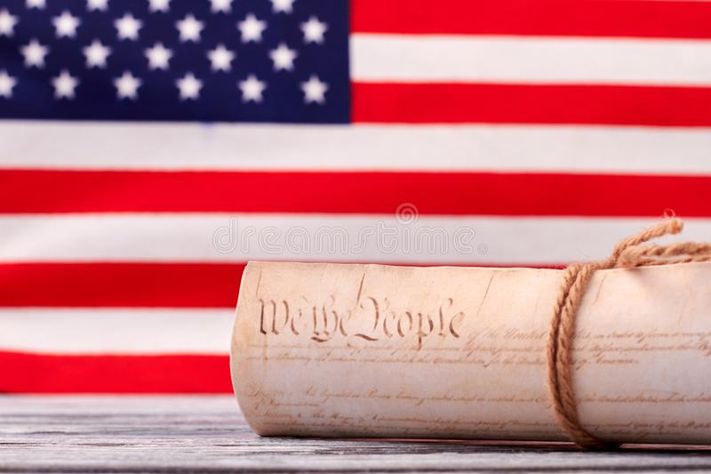 Close up Constitution of US on USA flag background. Declaration of Independence of the United States of America with american flag in the background royalty free stock photo