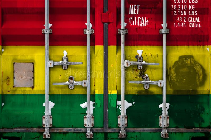 The concept of export-import and national delivery of goods. Close-up of a container with the national flag of Bolivia. The concept of Bolivian export-import and vector illustration
