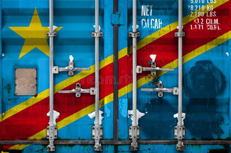 The concept of export-import and national delivery of goods. Close-up of a container with the national flag of the Democratic Republic of the Congo. The concept stock illustration