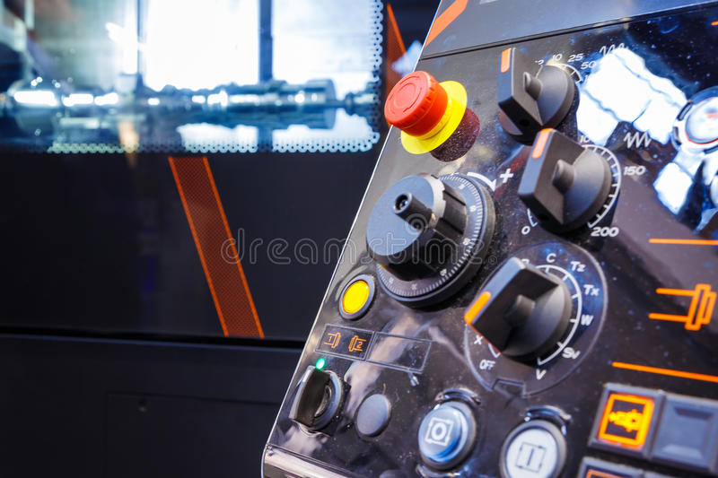 Close up of control panel of CNC machine with adjustment controls and push buttons. Selective focus. royalty free stock photos