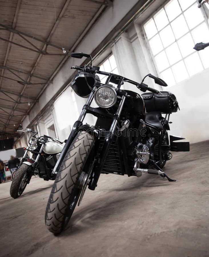 Close up. cool motorbikes on show in the showroom. Biker stuff stock photo