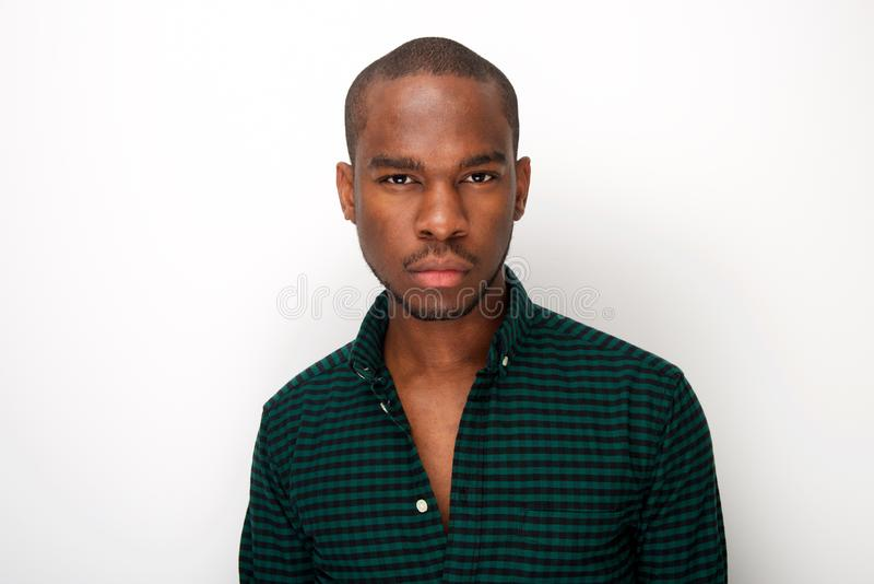 Close up cool young african american male fashion model against isolated white background royalty free stock photography