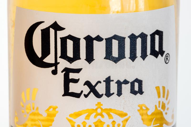 Close-up for Corona Extra logo on the bottle. Corona Extra is pale lager produced by Cerveceria Modelo in Mexico. Pruszcz Gdanski, Poland - March 9, 2019: Close stock photos