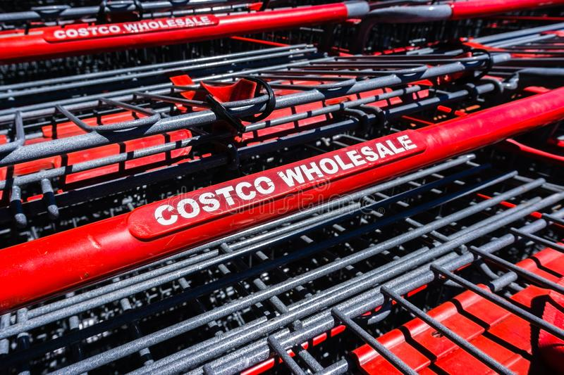 Close up of Costco Wholesale logo printed on the shopping carts. August 6, 2018 Mountain View / CA / USA - Close up of Costco Wholesale logo printed on the stock photography