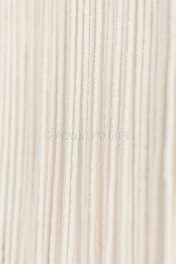 Close up of cotton macrame panel yarn in a minimalistic scandinavian wall. Texture. Background. royalty free stock photography