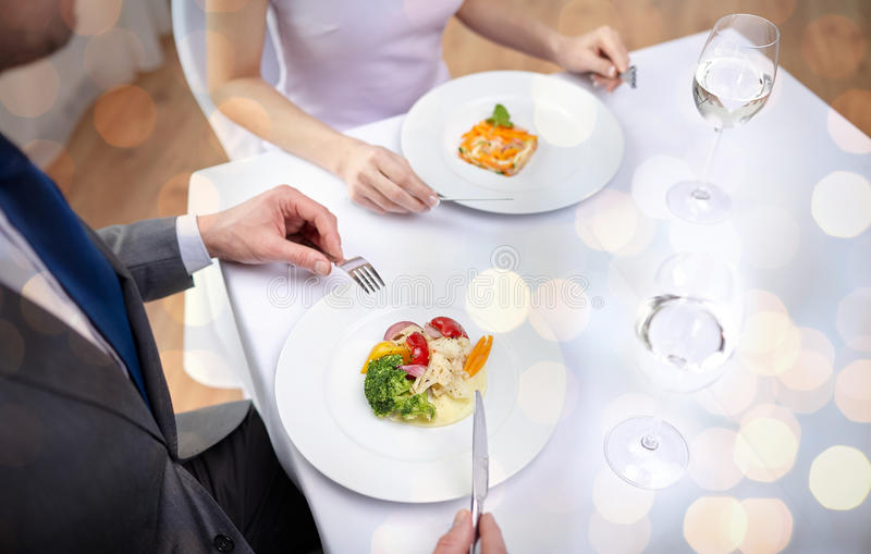 Close up of couple eating appetizers at restaurant royalty free stock photography