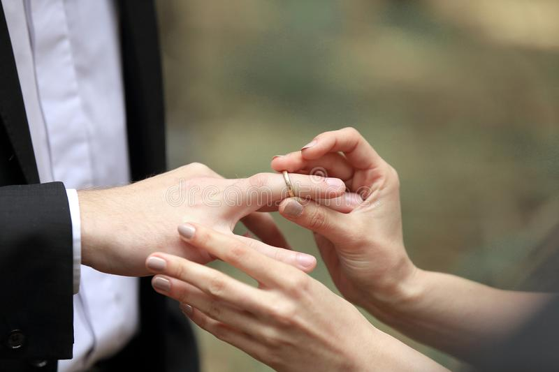 Close up. the couple exchanging wedding rings royalty free stock photos