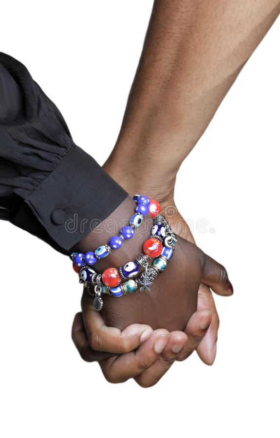 Close up of couple holding hands royalty free stock photo
