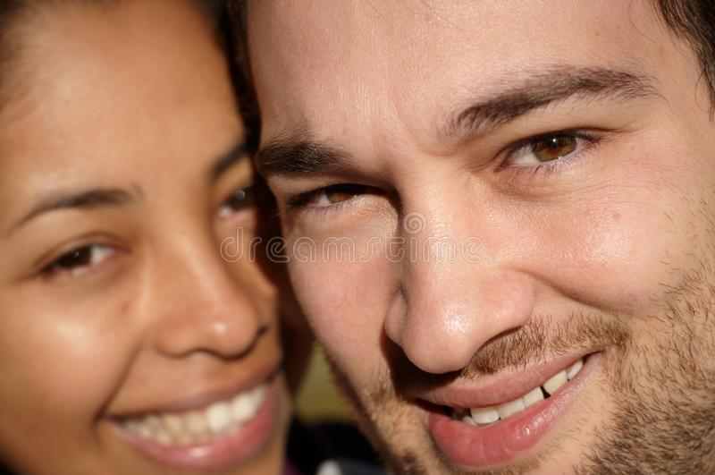 Close-up of a couple smiling in sunlight stock image
