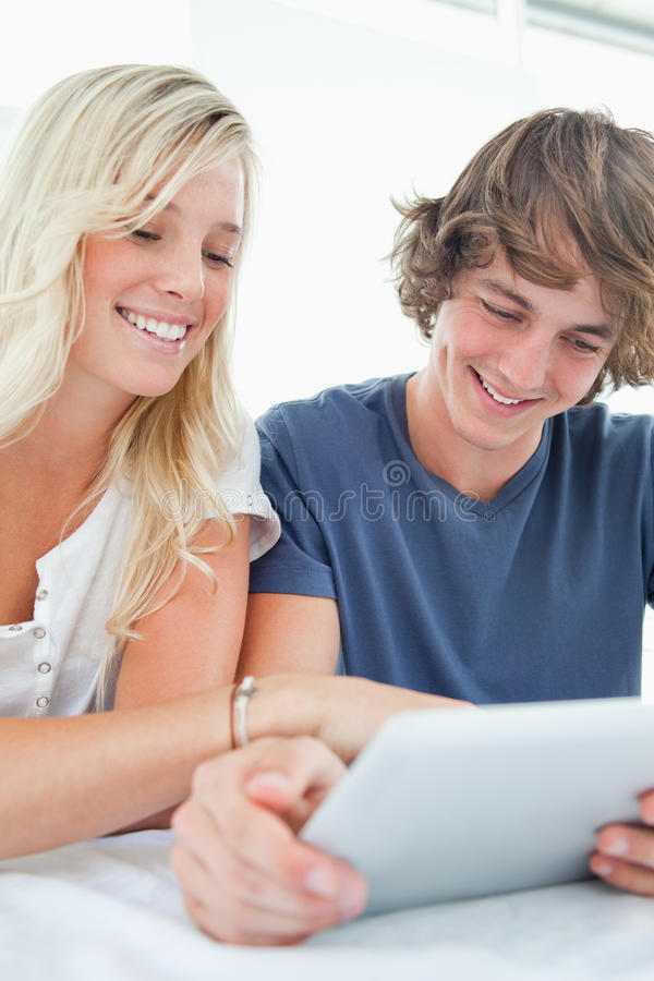 Close up of a couple using a tablet