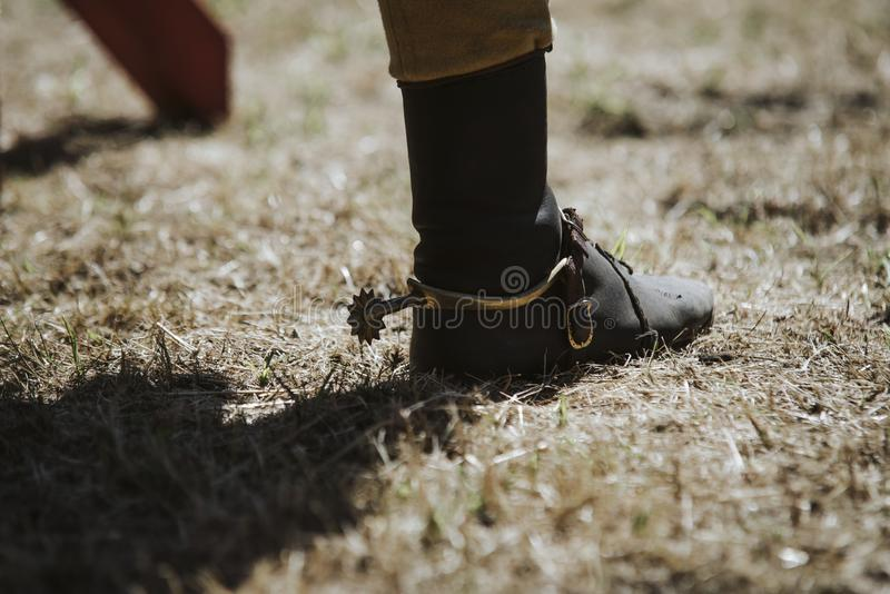 Close up on cowboys boot on the grass royalty free stock photos