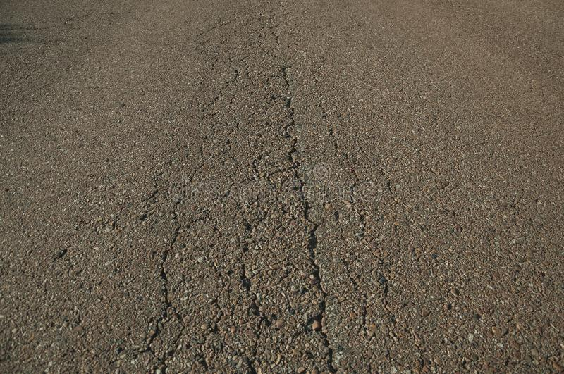 Close-up of cracked asphalt on a road royalty free stock image