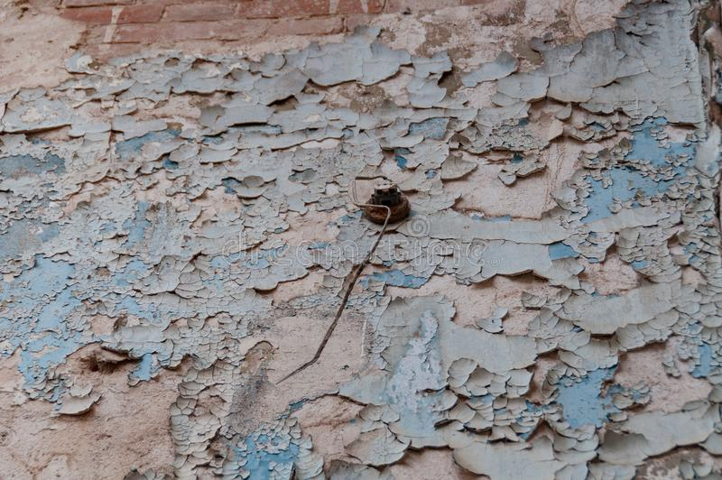 Close up of cracked paint, flaking off wall royalty free stock image