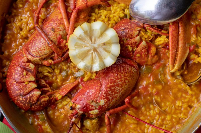 Close-up of creamy rice with lobster, clams and other seafood. royalty free stock photography