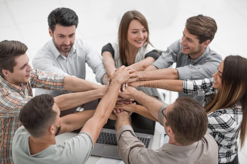 Close up.creative business team shows their unity stock photo