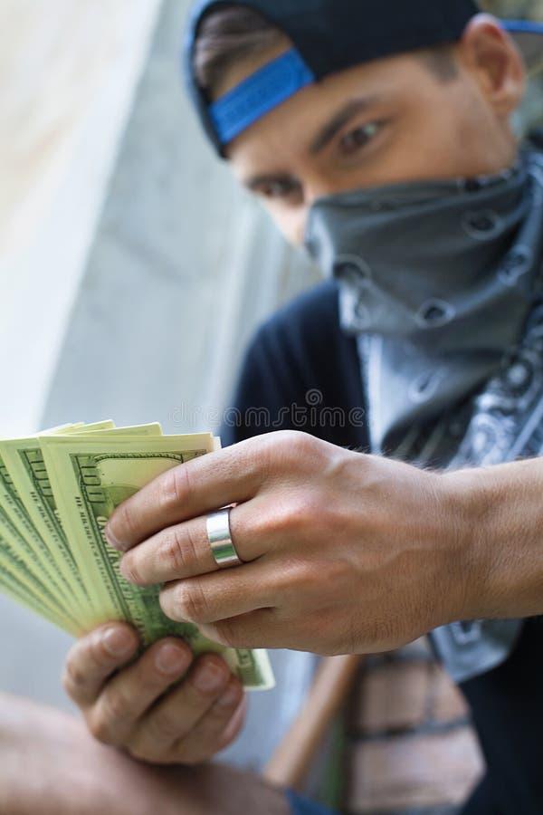 Close up of criminal man holding money. royalty free stock photos