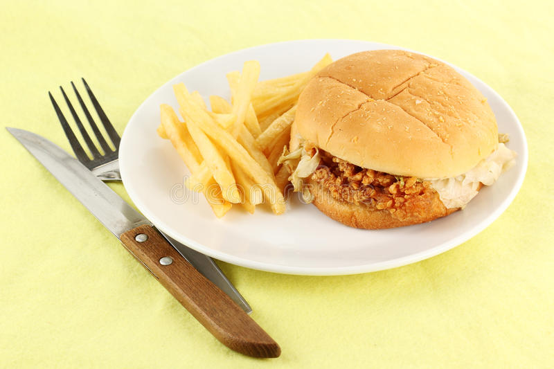 Close up crisp chicken burger with french fried. On the plate stock photography