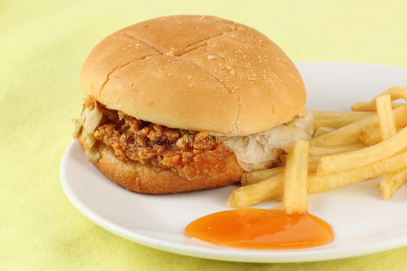 Close up crisp chicken burger with french fried. On the plate stock images