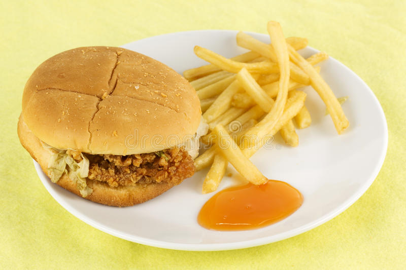 Close up crispy chicken burger with french fried. On the plate royalty free stock photography