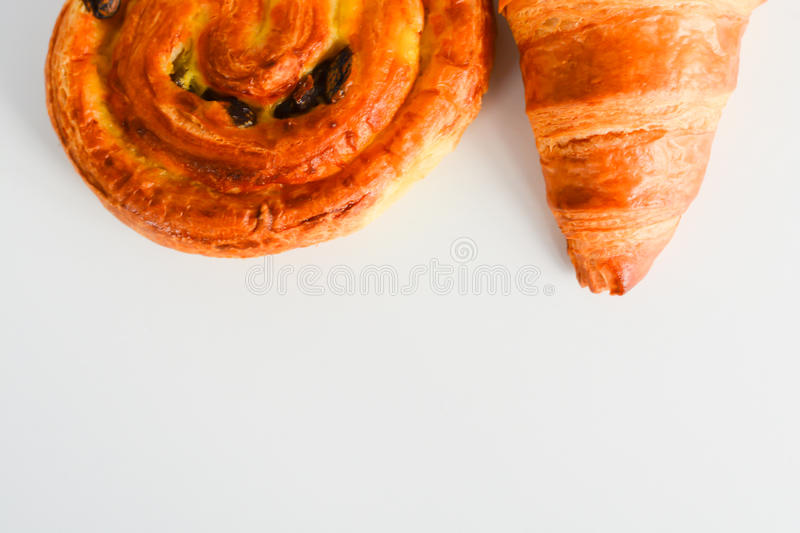 Close up on croissants, Danish pastry and chocolate and raisin filled pastries. Close up on croissants, Danish pastry filled with chocolate and raisin stock images