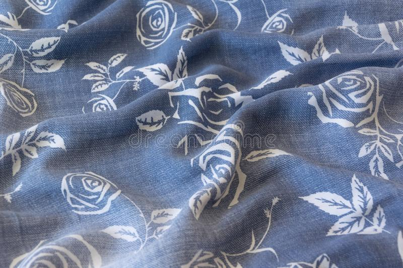Close up crop view of blue cloth with flower stock photo