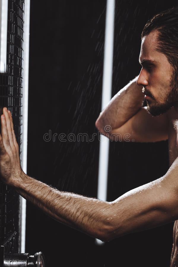 Close up cropped photo of blind man having a shower in showering cubicle. Close up cropped photo of blind man having a shower in the showering cubicle royalty free stock photos