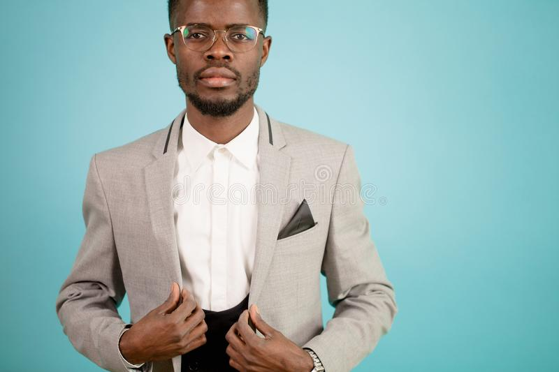 Close up cropped portrait of African business man in white suit isolated stock image