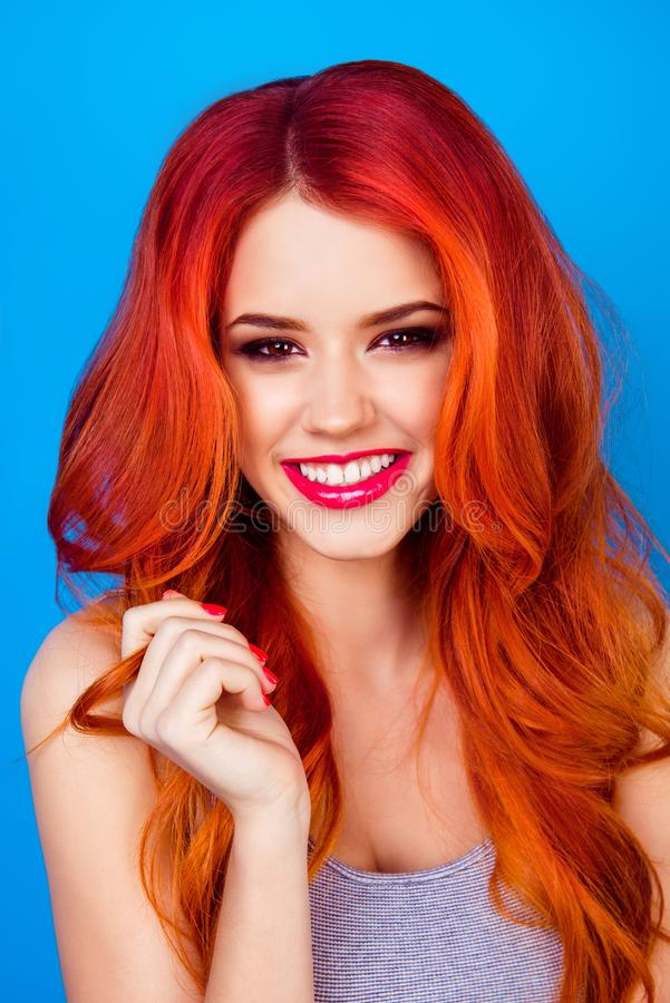 Close up cropped portrait of cute ginger model on blue back royalty free stock image