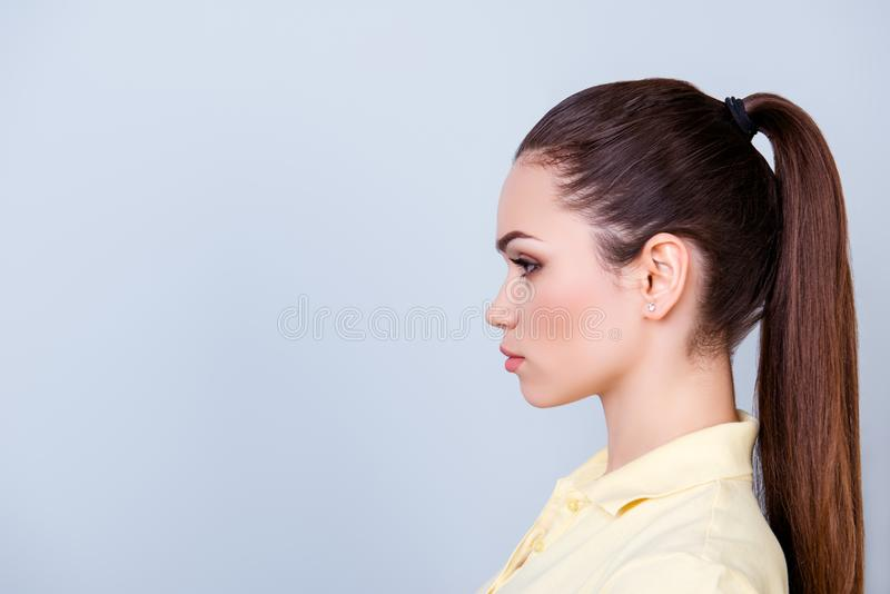 Close up cropped profile portrait of young lady in yellow tshirt royalty free stock image